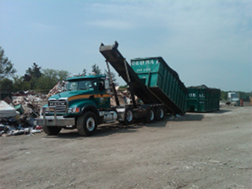 Disposal truck dumping waste